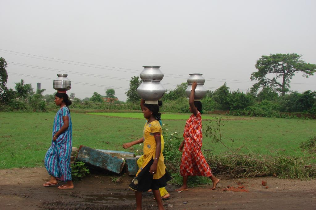 A group of ladies walking a long distance to get access to safe and clean drinking water